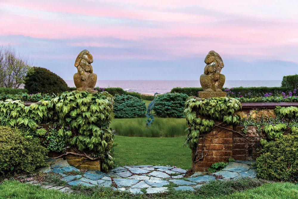 A glimpse of the Newport, RI, coast through the walled garden entrance
