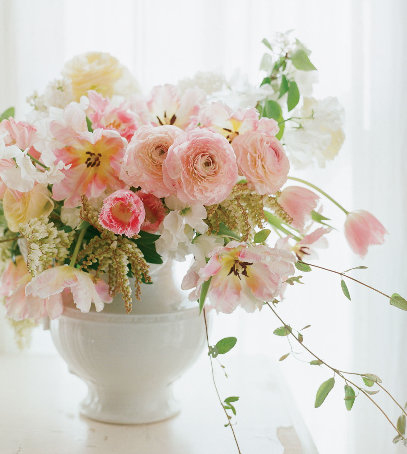 soft pink, romantic arrangement by Kate Holt, featuring tulips that have been manually opened