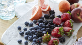 4th of July fruit platter on a teak dining table outside