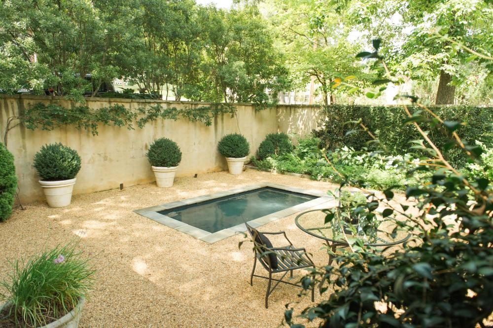 landscape after photo: walled courtyard with reflecting pool, pea gravel patio, and plantings