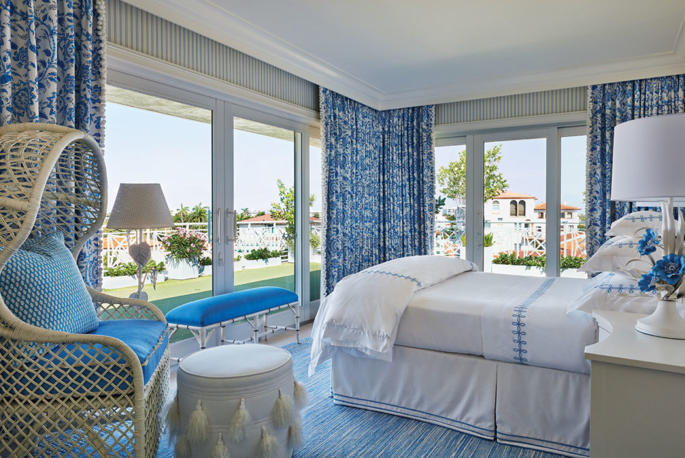 palm beach-style blue-and-white bedroom by Kemble Interiors