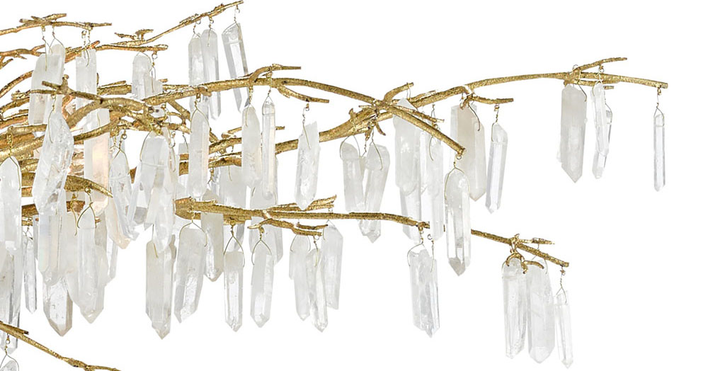close up of natural quartz crystals suspended from the golden branch-like arms of the Forest Light Chandelier from Currey & Company