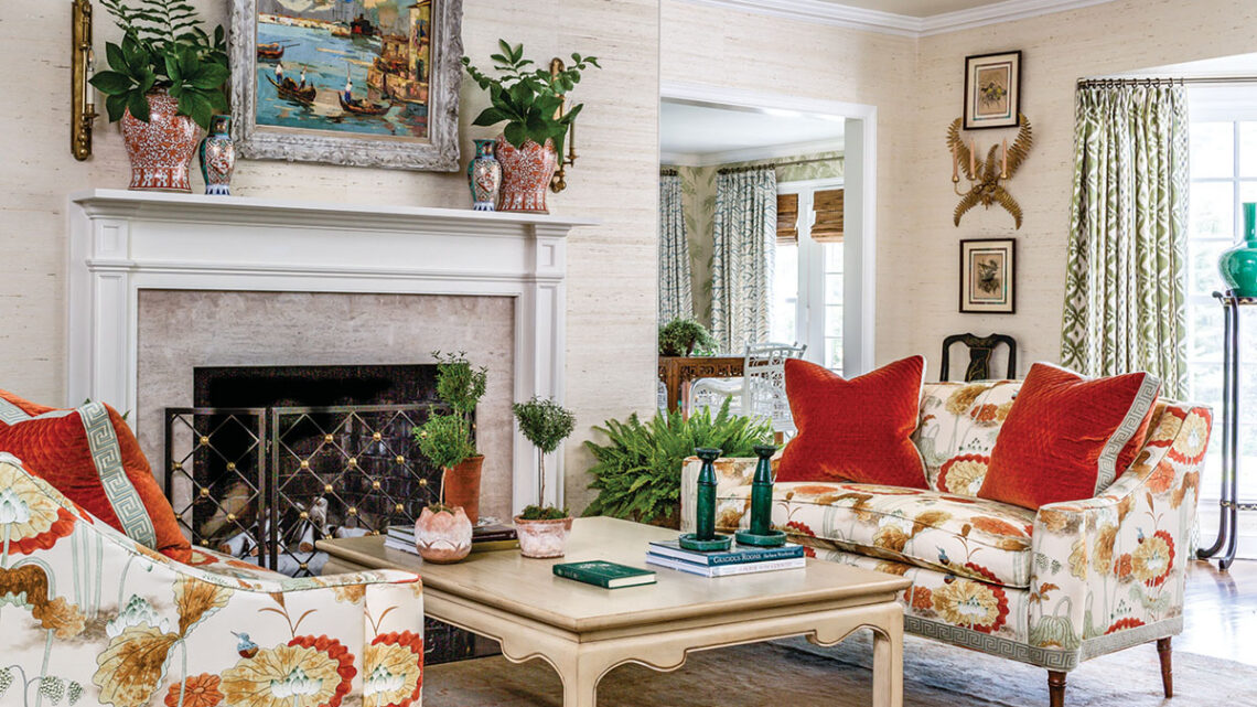 living room designed by James Farmer with grasscloth walls and fireplace.