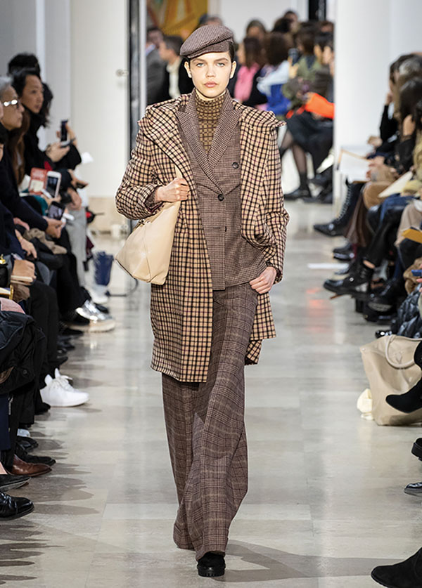 Menswear-inspired women's apparel at a fall 2020 runway show for Akris