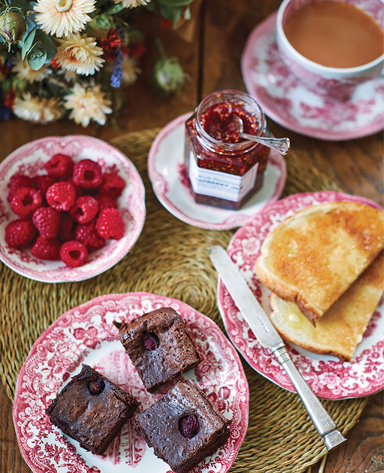 India Hicks raspberry brownies, with toast, jam, and tea in a scene from her book, An Entertaining Story