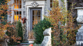 The ambience at Jardin de Buis starts as you enter through a door surround that once graced a New York City bank. The muted exterior colors blend with the lightly shaped boxwood and Carpinus betulus 'Fastigiata.'