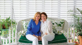 portrait of the founders of the skincare line Sapelo sitting together on a porch swing