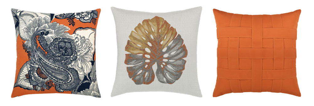 pillow designs include orange background with a white and navy floral paisley design; a metallic gold, silver, and copper leaf on a white background, and a basketweave pillow in bright orange