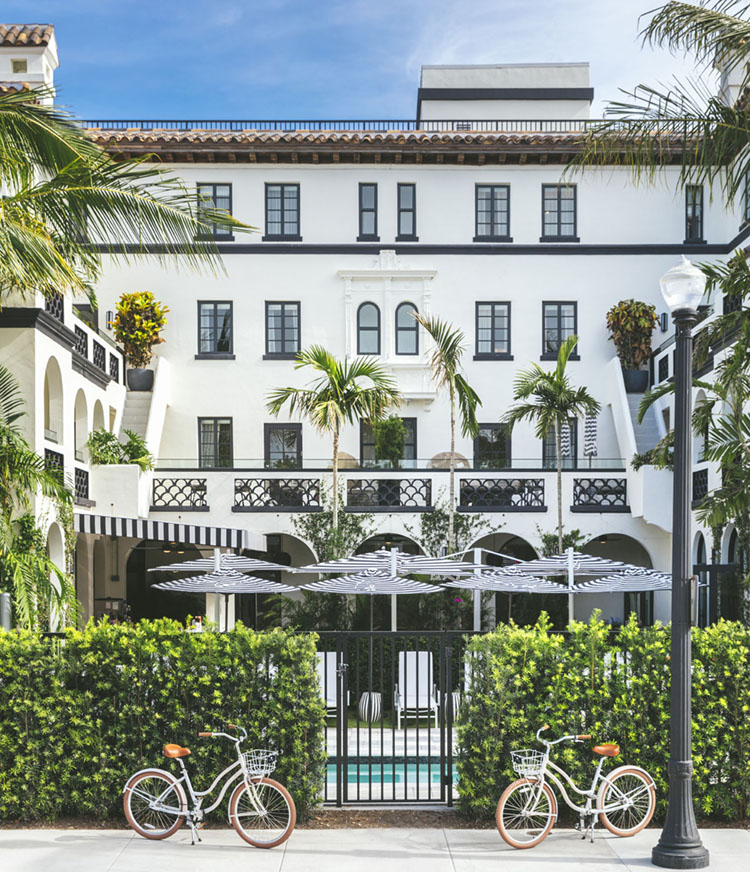 bikes in front of hotel with Spanish-style architecture