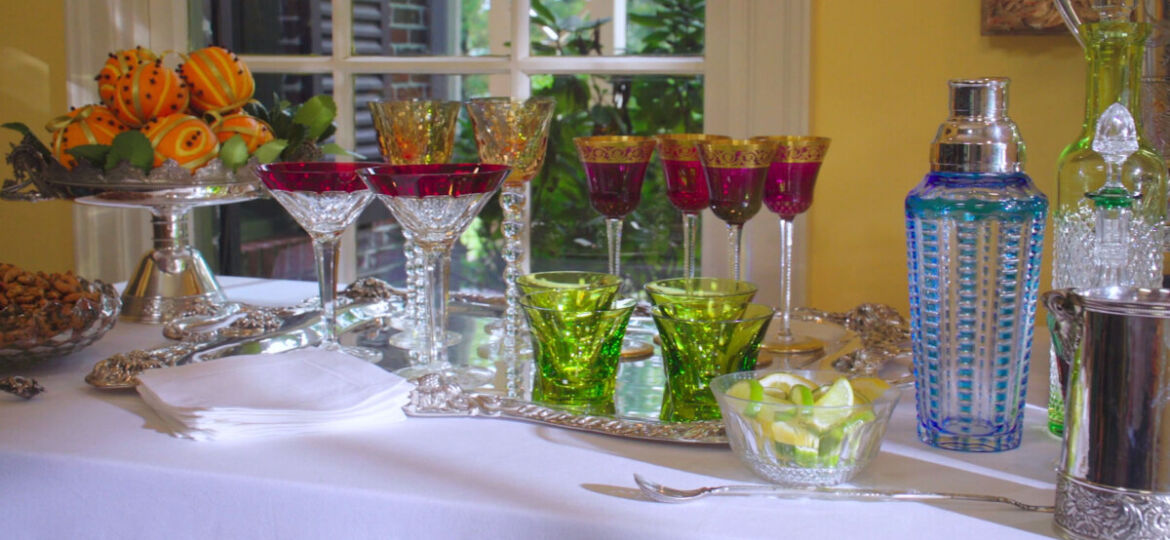 Holiday Bar featuring colorful glassware and silver pieces from Replacements