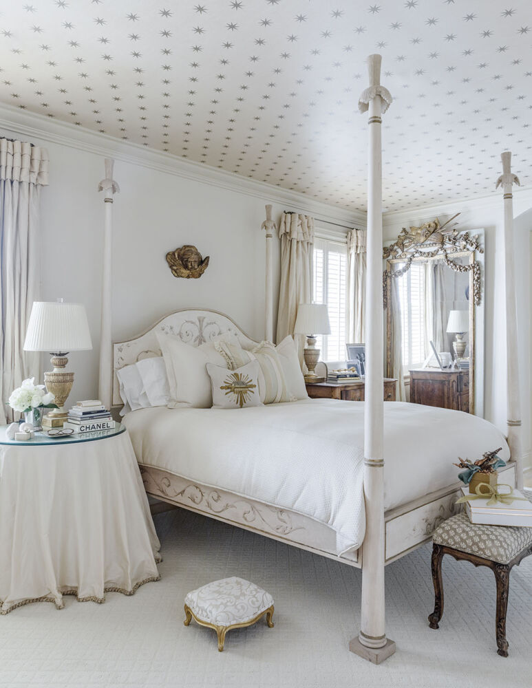 French provencal-style white master bedroom at home of Alex Rico in New Orleans