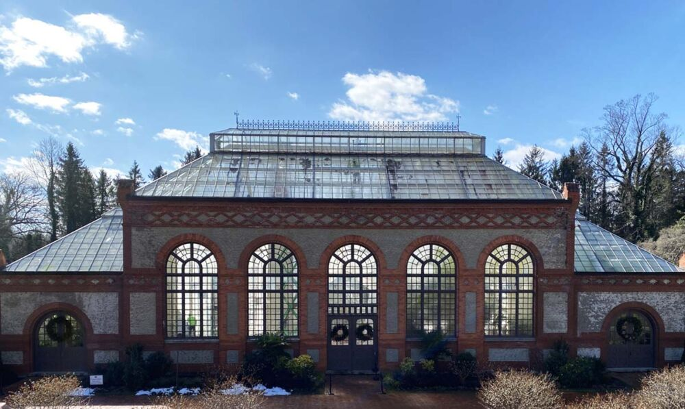 exterior view of the Conservatory on the Biltmore Estate at winter on a clear sunny day with blue skies