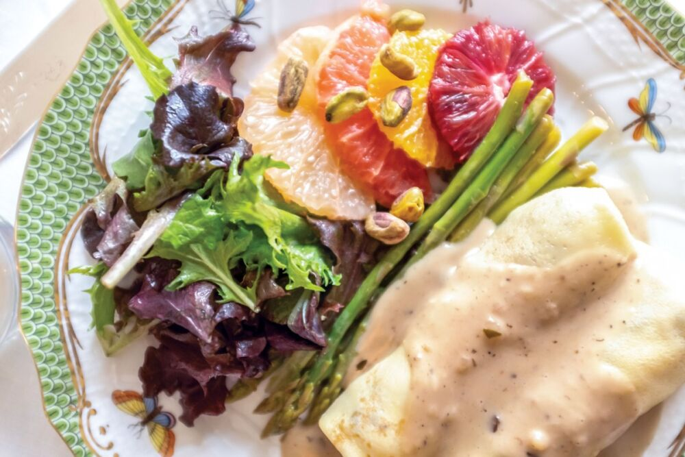 Chicken-and-mushroom crepes with asparagus, citrus salad, and mixed greens dressed in mustard vinaigrette