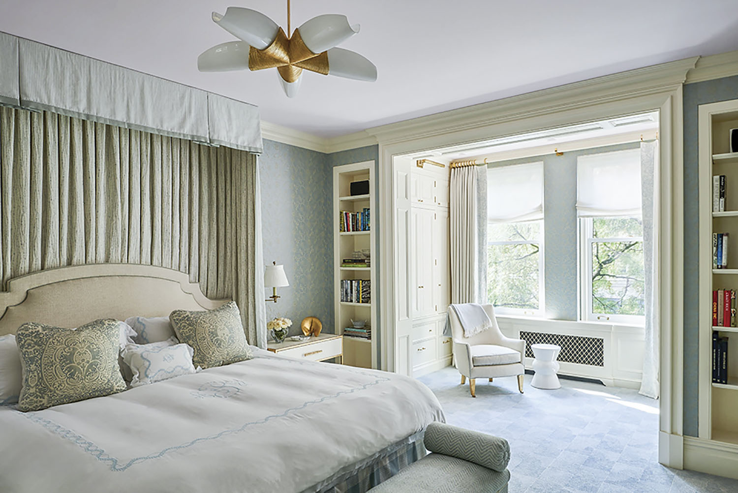 main bedroom in a serene soft sage palette, decorated by interior designer Phillip Thomas