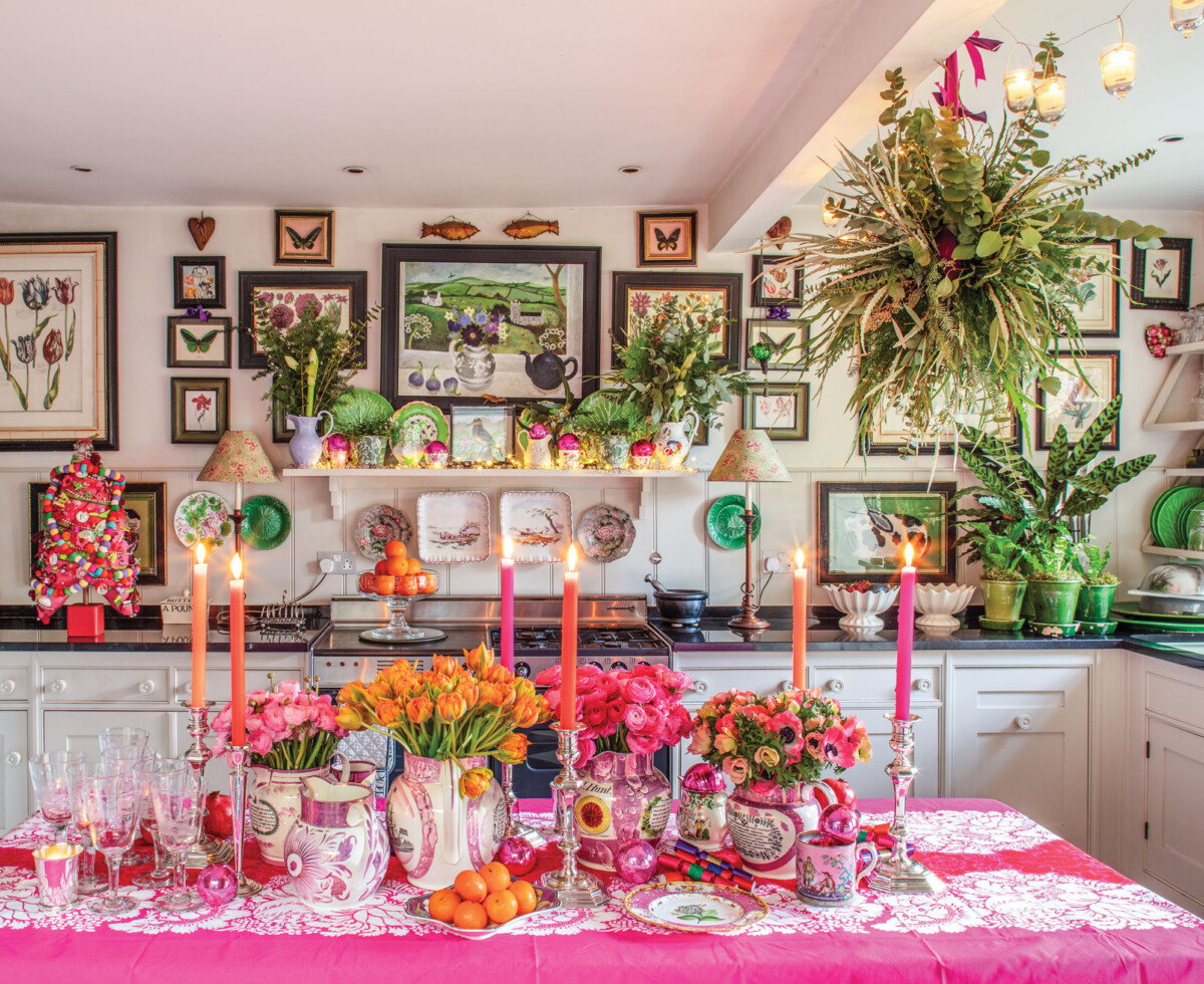 pink Christmas tabletop and kitchen decor by Butter Wakefield. KITCHEN - PINK TABLECLOTH, CANDLES, TULIPS, ANEMONES, RANUNCULUS