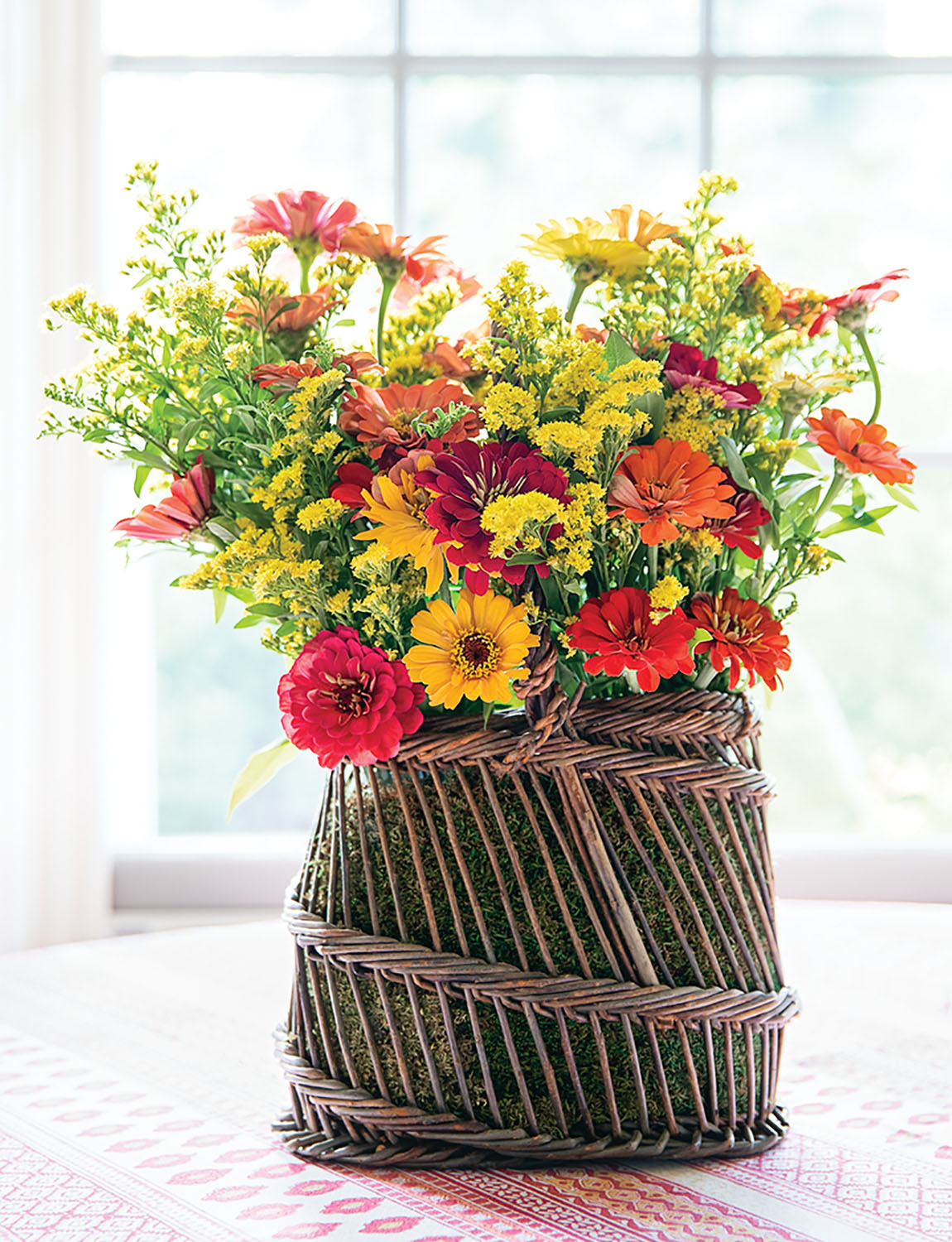 A colorful arrangement in a basket, from the pages of CHARLOTTE MOSS FLOWERS