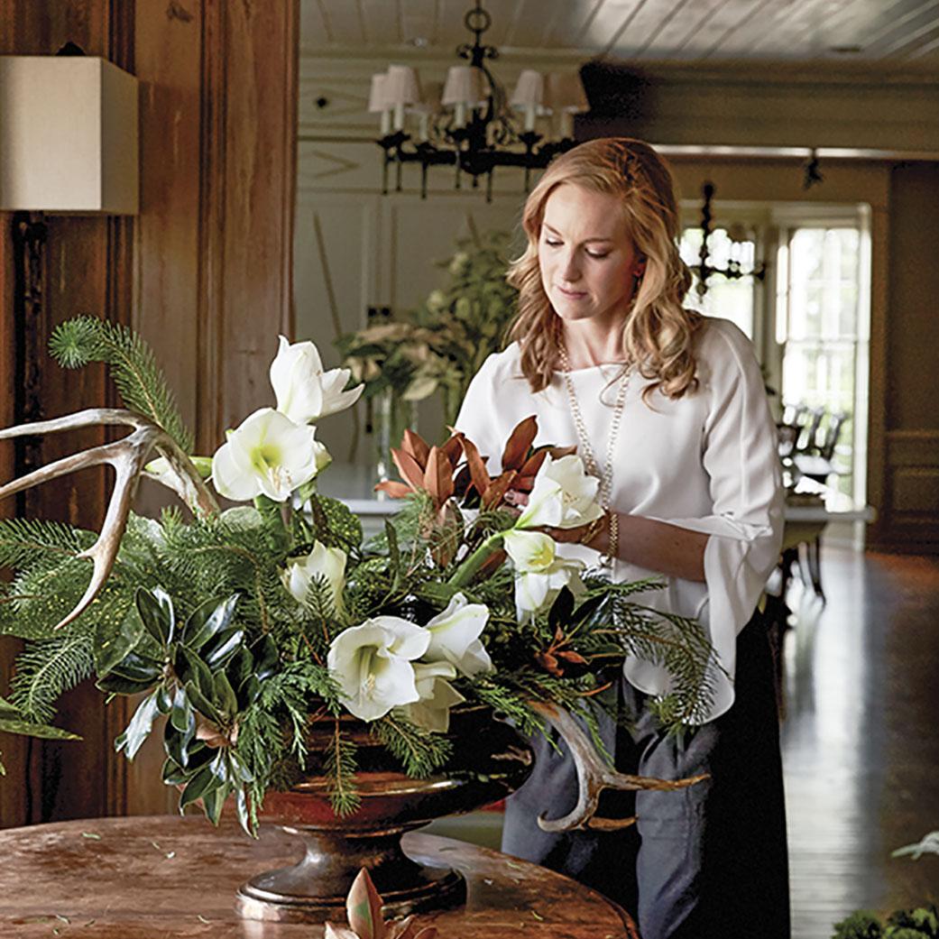 Step 3, Kakhi Huffaker Wakefield adds greenery to her floral arrangement