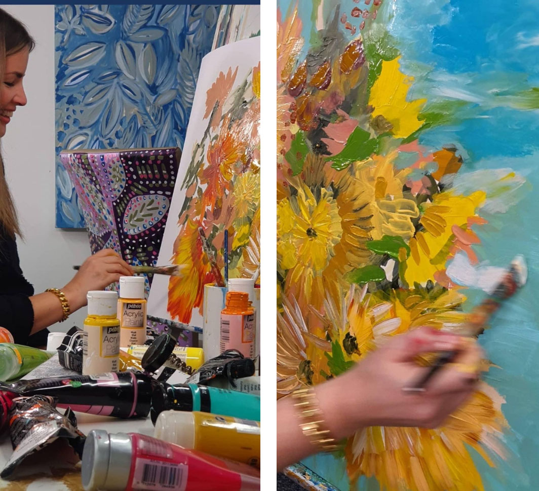 Artist Jan Erika at work on a floral painting based on a design by The Flower Hat