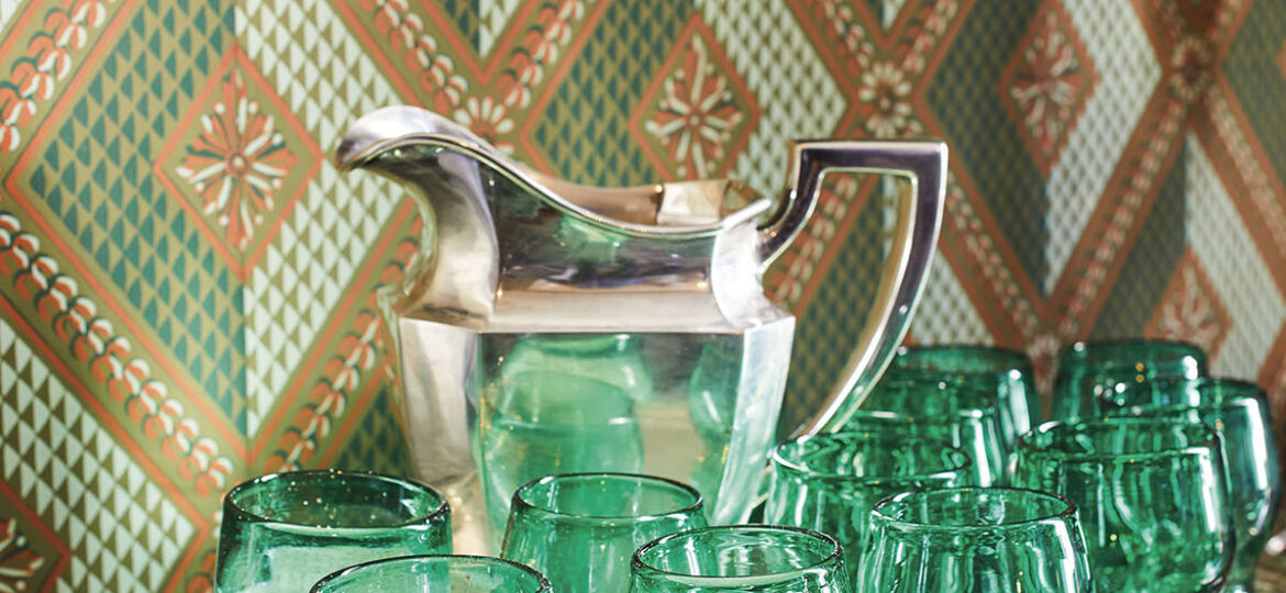 Julia Reed's Milk Punch served from a silver pitcher on a silver tray filled with green goblets