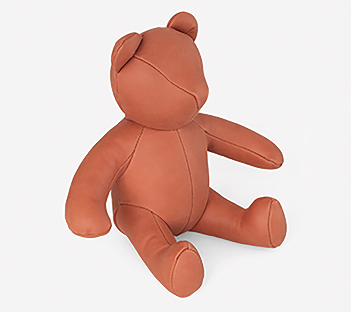 Colorful Home Decor and Accessories for 2021: color orange. Orange leather stuffed toy bear