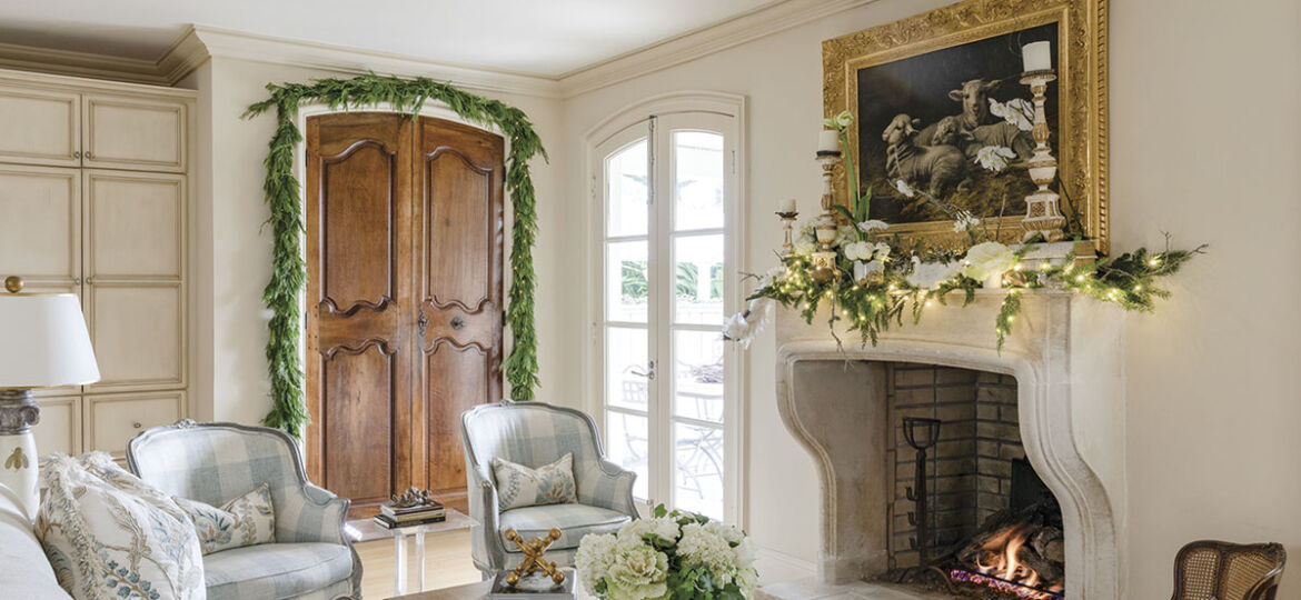 In the New Orleans home of Alix Rico and her husband, Paul, the family room's limestone fireplace is an authentic representation of the classic château-style fixture common in Provençal architecture. Antique walnut boiserie panels were retrofitted as closet doors. Kumquats, pomegranates, and decorative cabbage enhance the garden-fresh flavor of the room, which is situated between the kitchen and the back porch.