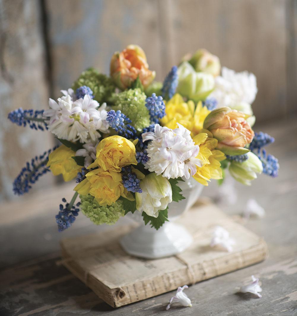 blue, white, yellow and peach arrangement by floral designer Sandra Sigman