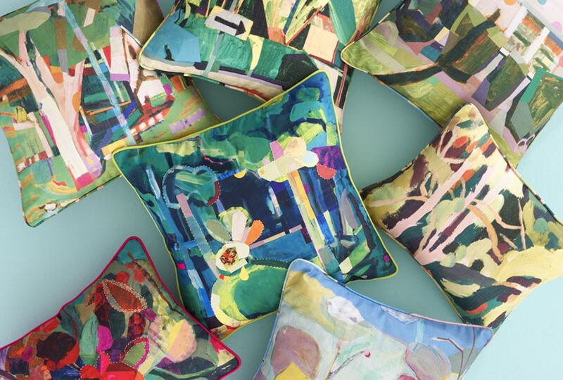assorted colorful decorative pillows printed with nature-inspired artwork by Cynthia Wick in a new collection for Annie Selke Spring 2021 home decor collection