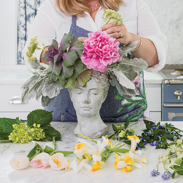 Step 4, Martha Whitney Butler of The French Potager demonstrates adding focal flowers