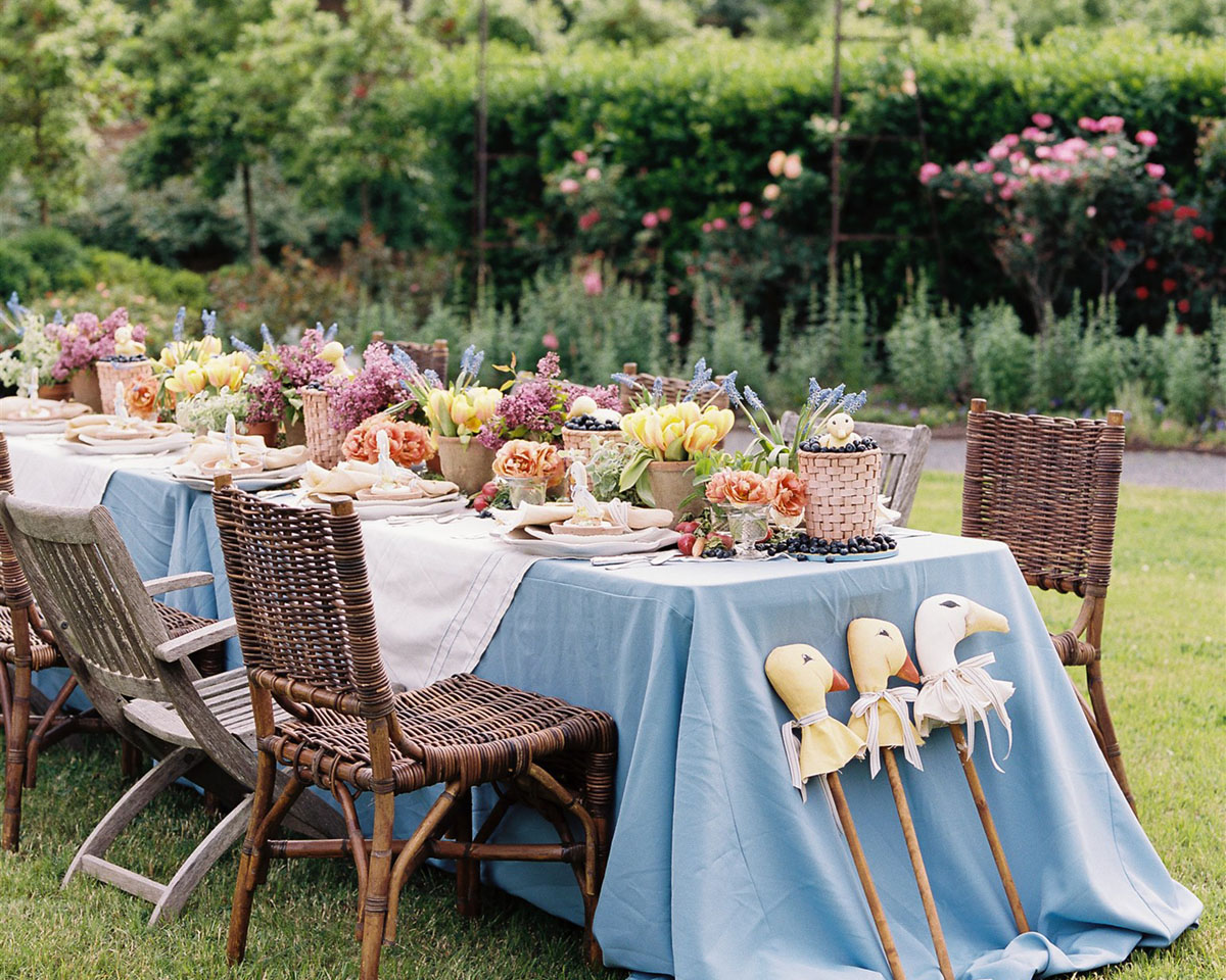 A flower-filled spring luncheon table set in the rose garden at Moss Mountain Farm, created by The Velvet Boxwood for duck, duck, goose-themed children's social