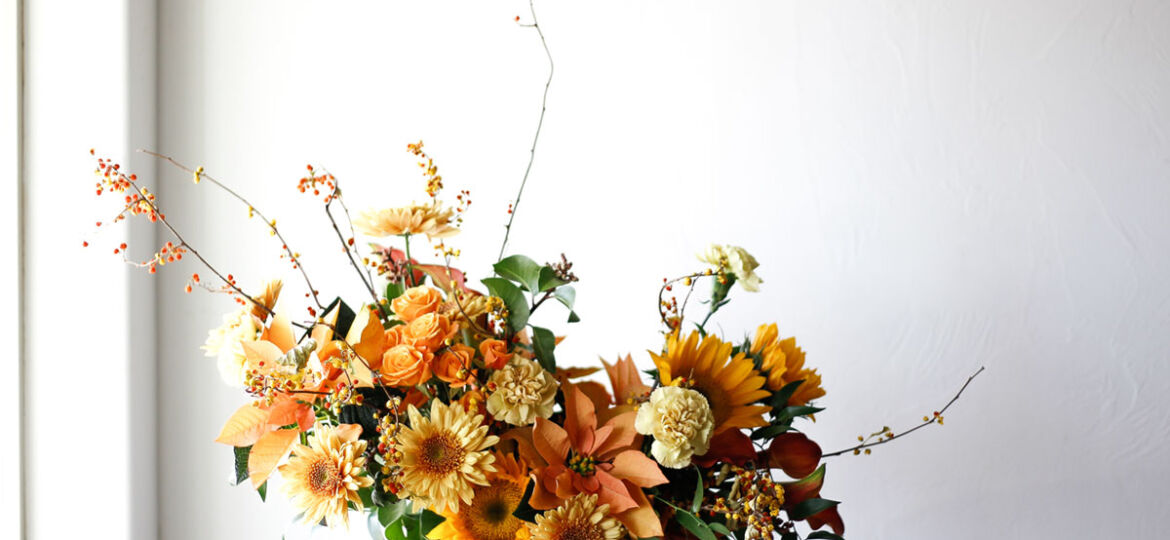 Yellow flower arrangement by The Flower Hat