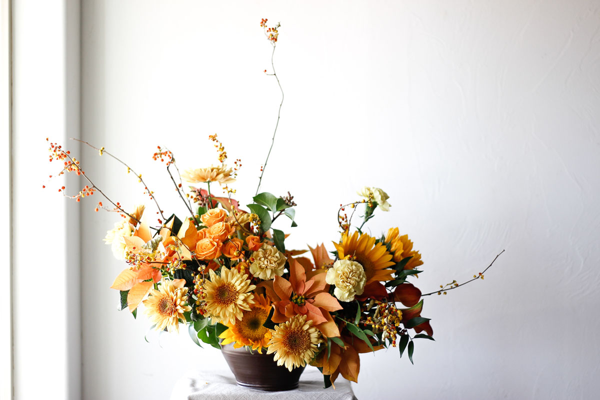 Yellow flower arrangement by The Flower Hat
