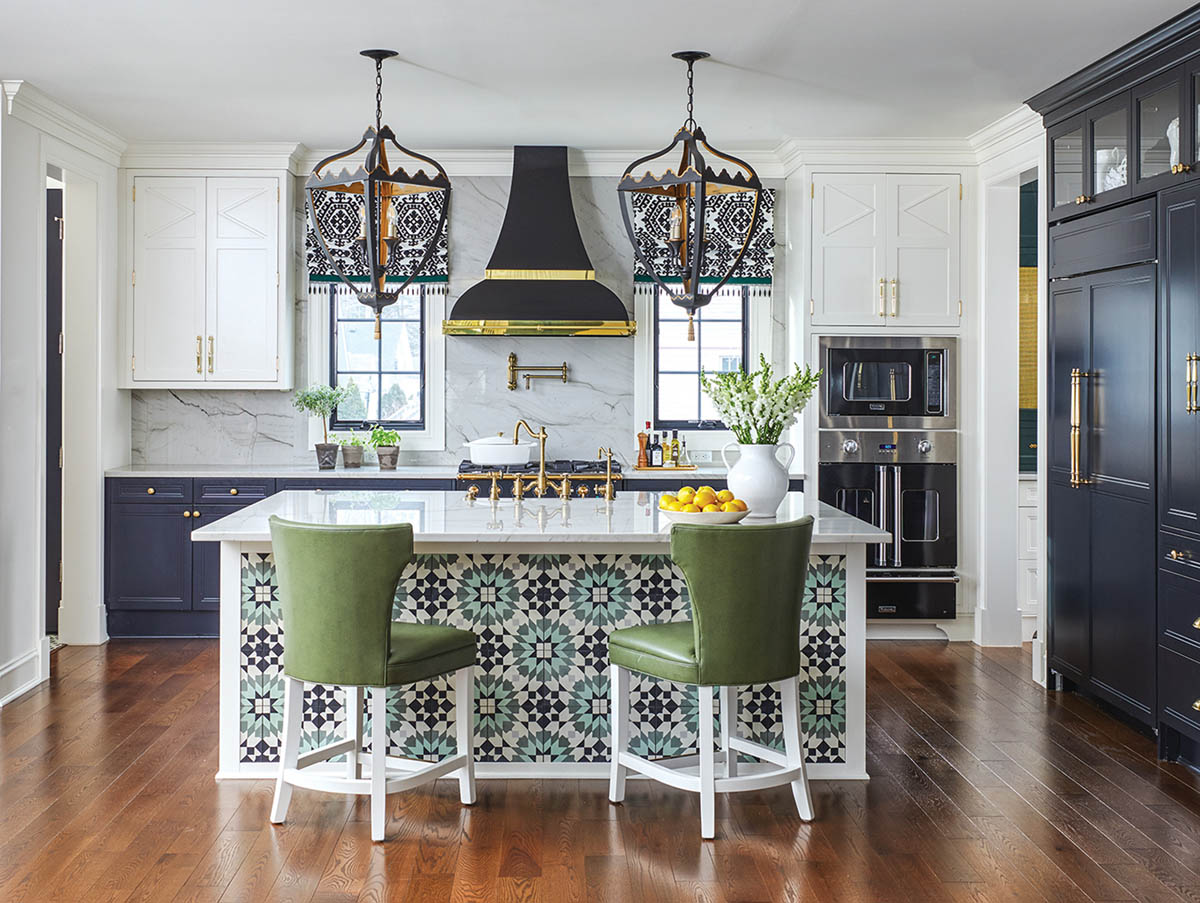 kitchen with navy cabinets and white, green, and aqua accents by interior designer Corey Damen Jenkins