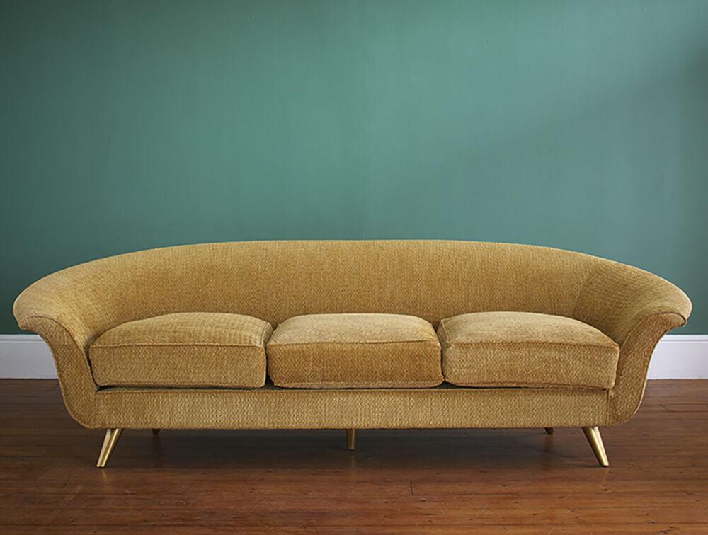 modern sofa upholstered in a gold-colored velvet