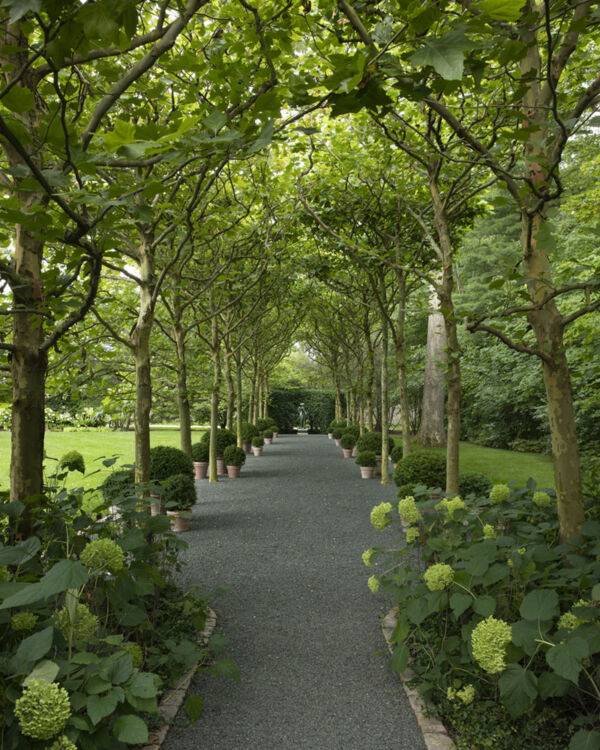 """Caption from the book Gardens of the North Shore of Chicago: """"A sculpture by John Kearney terminates the allée of scaling-bark plane trees."""" (Crowe Garden in Lake Forest)"""