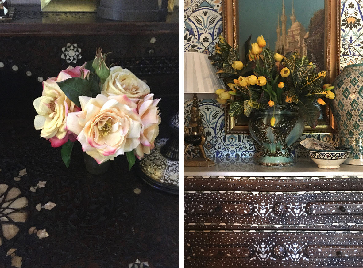 (left) small vase of white roses tinged with pink (right) vase of yellow tulips on a chest of drawers