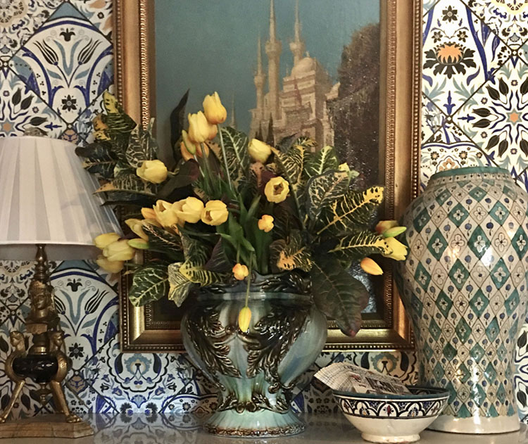 vase of yellow tulips in a vignette featuring Moroccan-inspired decor