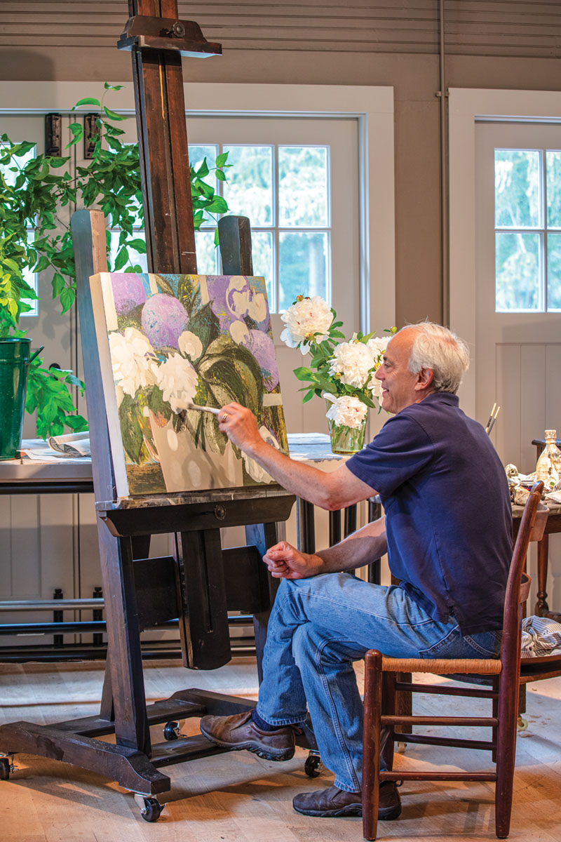portrait of artist John Funt (the son of Allen Funt of Candid Camera fame) painting flowers in his home studio