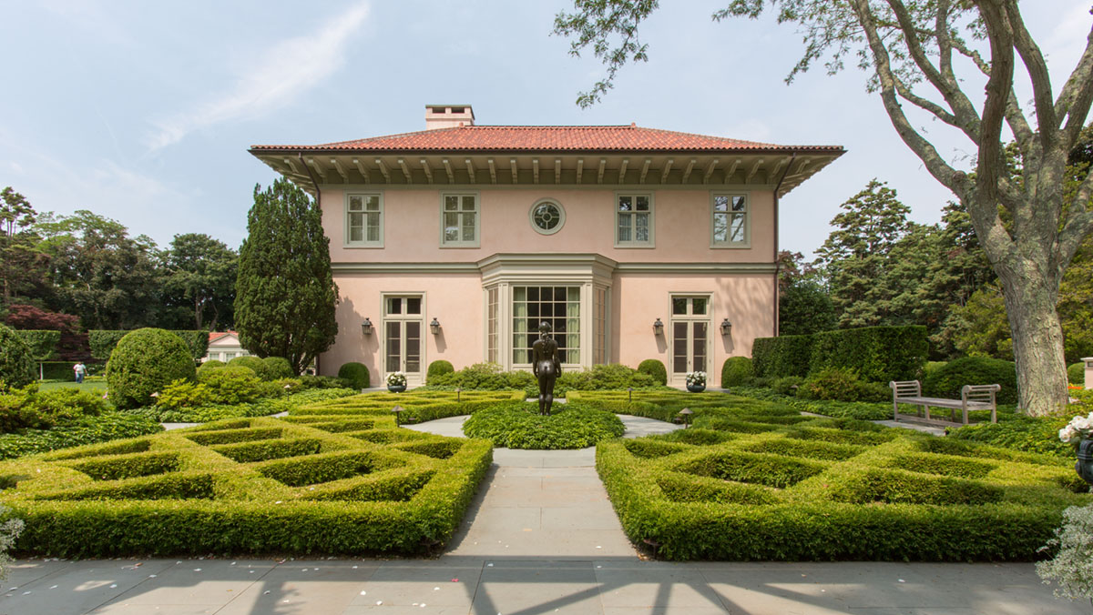formal front landscape for a Spanish Revival style home