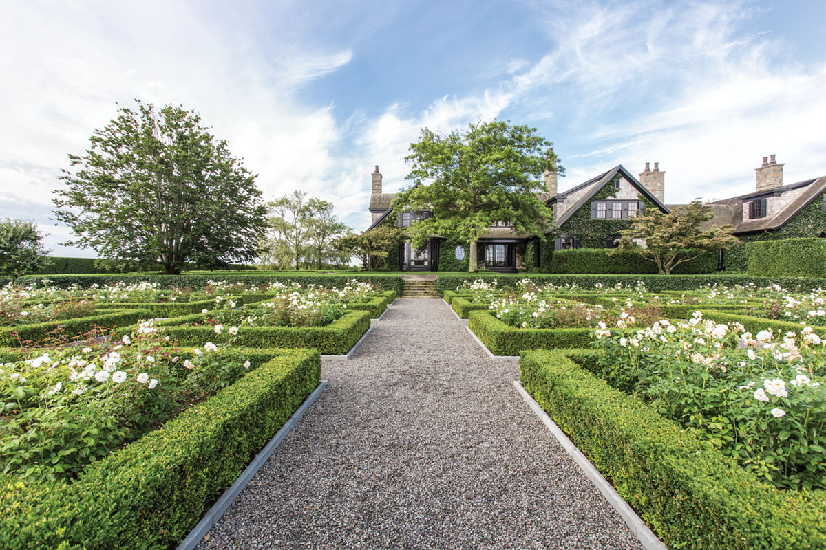 hedged garden parterres filled with roses