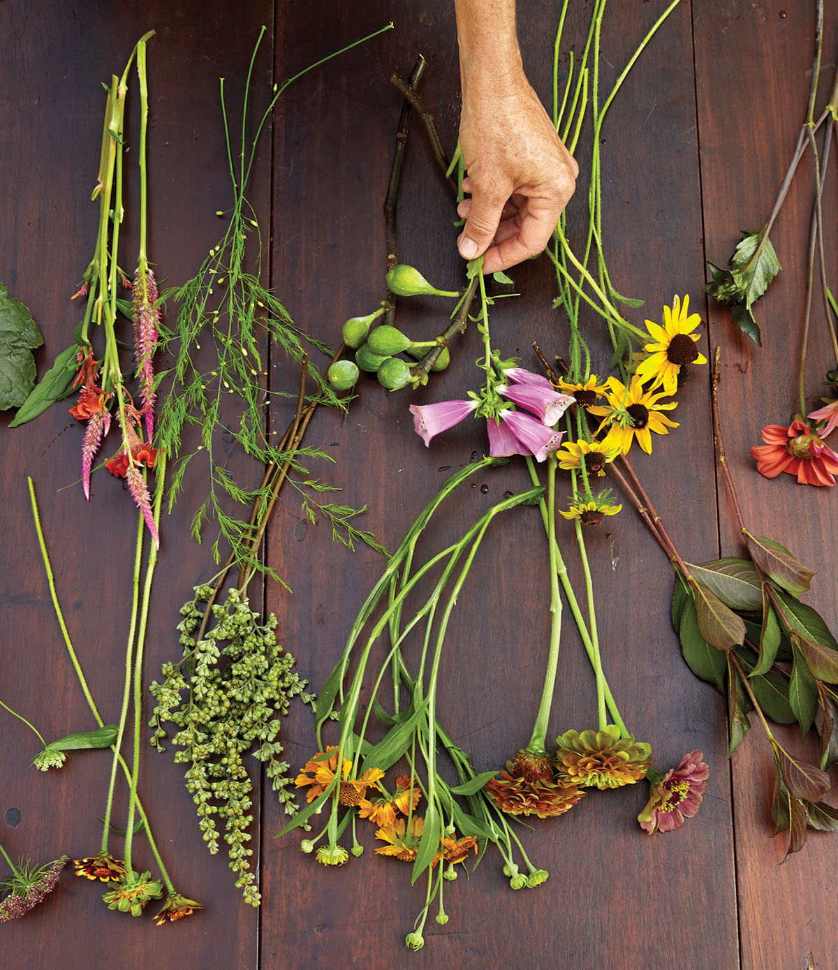 flowers and foliage for Kappi Naftel's floral tutorial laid out on a wooden work surface