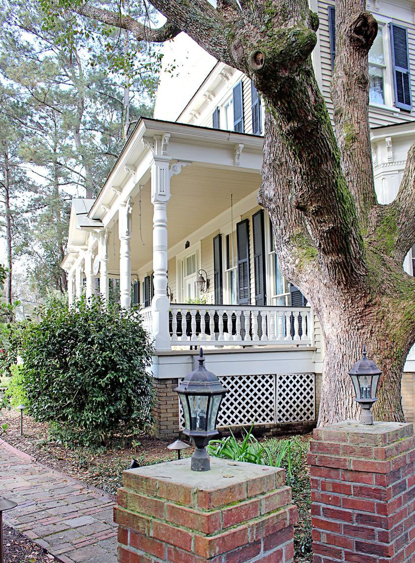 Flowertown Bed and Breakfast, a white frame house with a classic Southern front porch