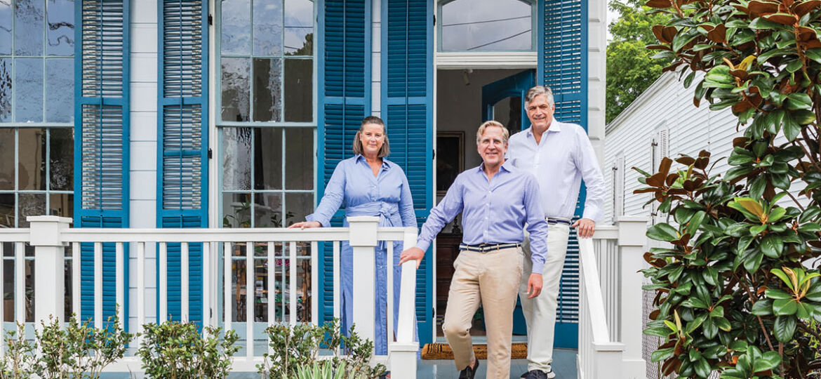 A historic New Orleans home, painted white with blue shutters, where Brockschmidt & Coleman and Sud are headquartered