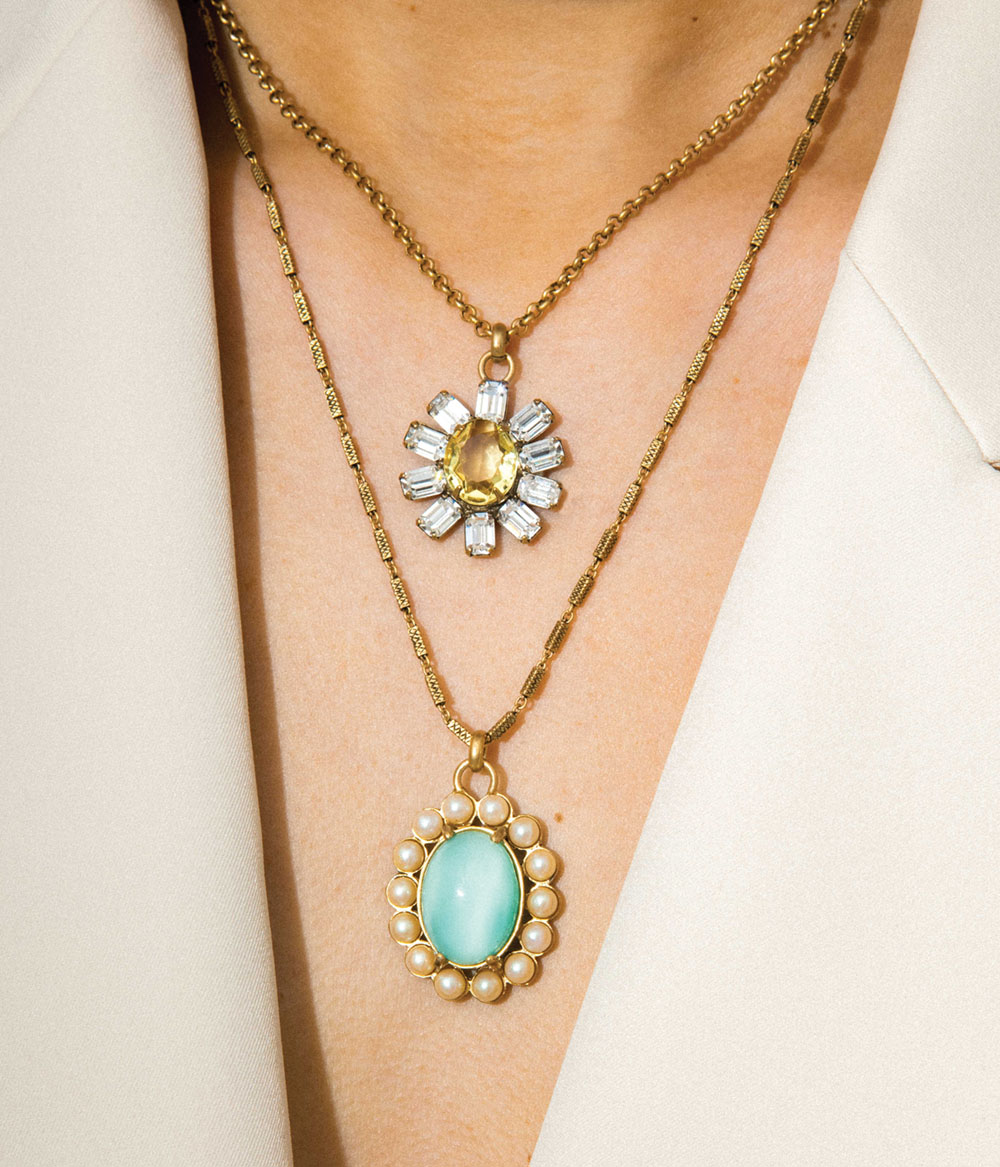 a pair of short and long pendant necklaces worn by a model, by Lauren Hope
