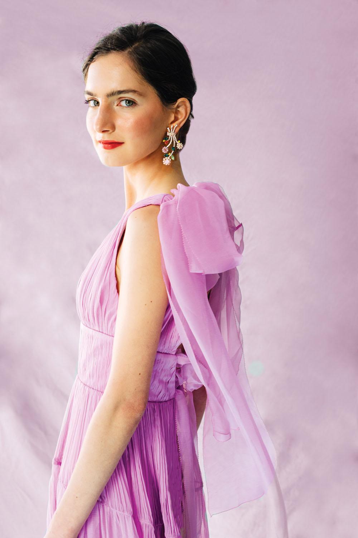 bejeweled floral earrings worn by a model in an elegant chiffon lavender dress