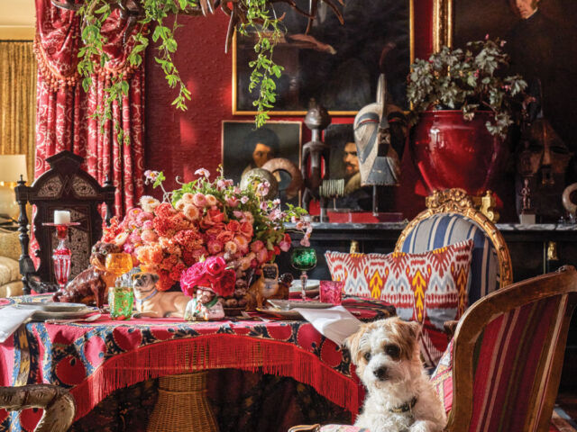 Michelle Nussbaumer's moody red dining room, decorated with floral arrangements by Jimmie Henslee