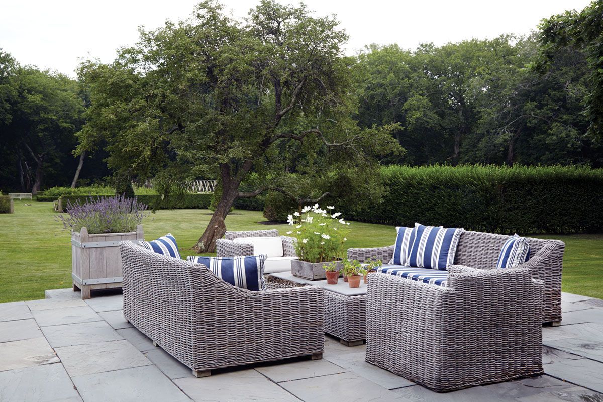 uncovered patio, woven outdoor furniture with blue and white striped cushions, Hamptons garden