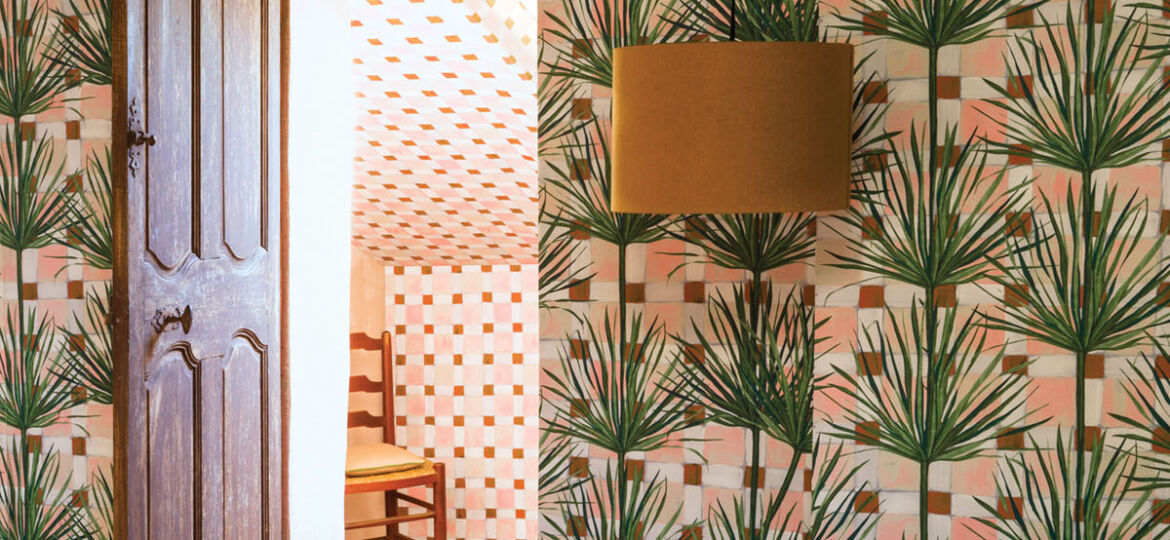 a room papered in a tropical leaf print from Pierre Frey
