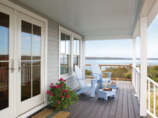 Hinged Outswing Patio Doors, Double-Hung Windows with grilles dividing each into 4 equal quadrants