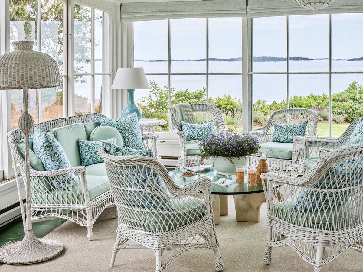 A white, blue and aqua sunroom designed by Meg Braff boasts sweeping ocean views