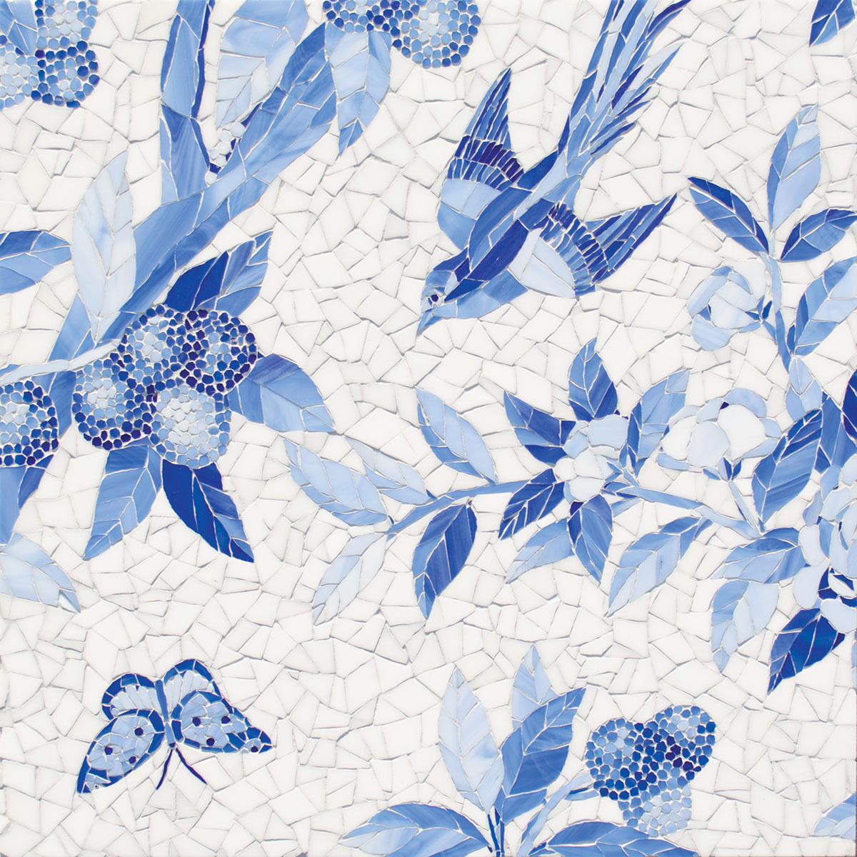 blue-and-white wall mosaic depicting butterflies, birds, and leafy stems of berries from New Ravenna's collaboration with Gracie Studio